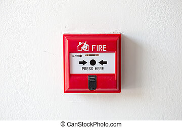 Push button switch fire alarm box on cement wall for warning and security system