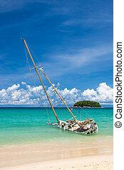 Abandoned shipwreck on the coast at kata beach Phuket Thailand, tourist landmark