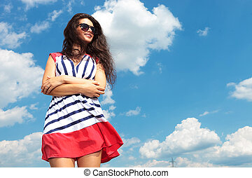 young brunette woman holding her hands crossed - Down view...