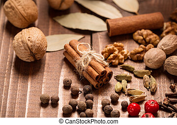 Collection of spices for mulled wine and pastry on the...