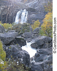 Waterfall Cascading water in natural rocky environment,...