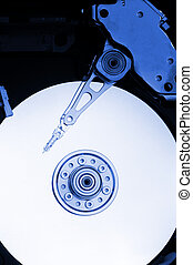 Hard drive interior, head on the disc surface, blue tint