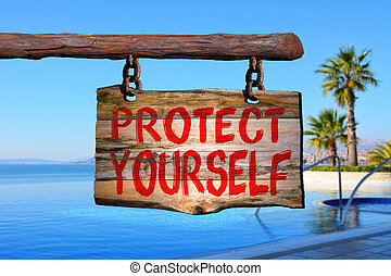 Protect yourself sign with blurred background