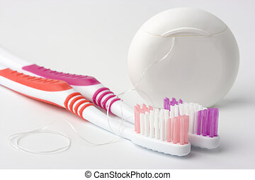 Two toothbrushes and dental floss - common toiletries