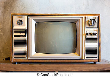 retro tv with wooden case in room with vintage wallpaper on wood table