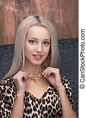Woman wearing shiny necklace