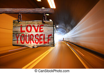 Love yourself sign with tunnel motion blurred background