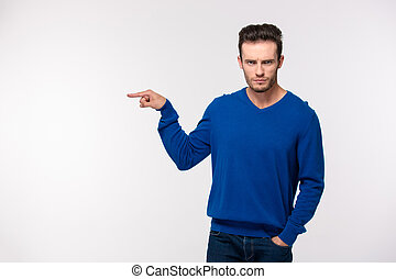 Portrait of angry man pointing finger away