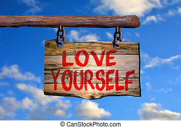 Love yourself sign with sky blurred background