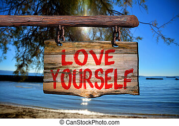 Love yourself sign with beach blurred background