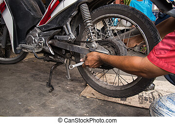 Motorcycle tire repair - The mechanic tire of the...
