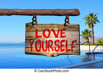 Love yourself sign with tropic blurred background