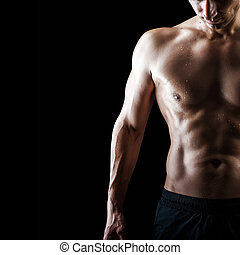 muscular handsome sexy guy on black background - Close up...