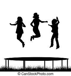 Children jumping on garden trampoline - Children silhouettes...