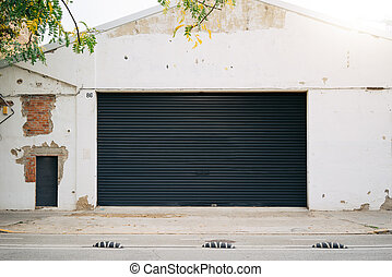 The photo of a house facade with  black shitter door.