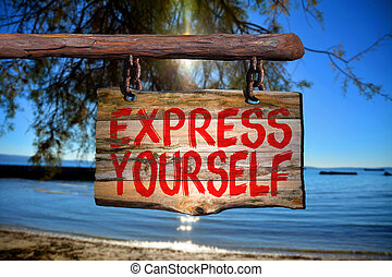 Express yourself sign with beach blurred background