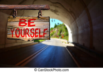 Be yourself sign with tunnel blurred background