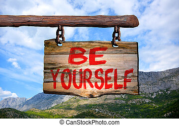 Be yourself sign with mountain blurred background