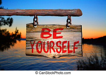 Be yourself sign with sunset blurred background