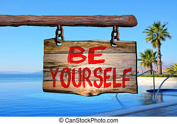 Be yourself sign with tropic blurred background