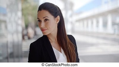 Beautiful Business Woman Looking at Camera While She...