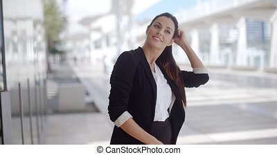 Elegant businesswoman standing waiting - Elegant young...