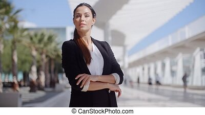 Thoughtful businesswoman with folded arms - Thoughtful...