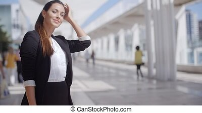 Smiling happy confident young businesswoman