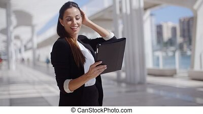 Smiling woman surfing the internet - Smiling attractive...