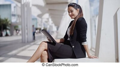 Elegant business manageress working on a laptop