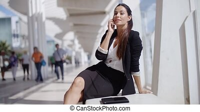Businesswoman taking a call on her mobile