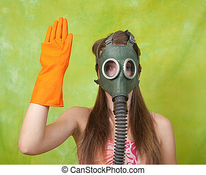 girl in gas mask pointing STOP over green background