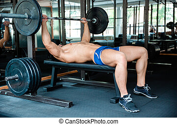 Handsome man workout with barbell - Portrait of a handsome...