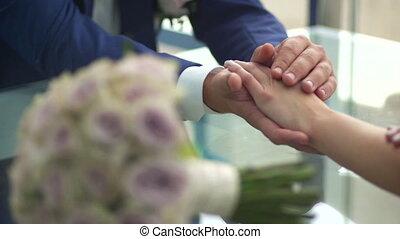 Bride stroking hands of the bride