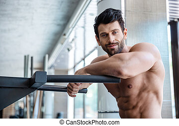 Handsome man resting near parallel bars - Portrait of a...