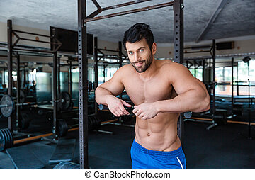 Male bodybuilder resting near parallel bars - Portrait of a...