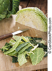 Fresh Savoy (close-up shot) on vintage wooden background