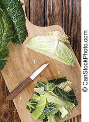 Portion of fresh Savoy close-up shot on wooden background