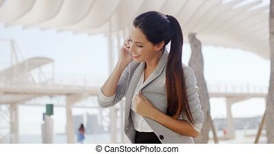 Woman using a mobile in a high key environment - Attractive...