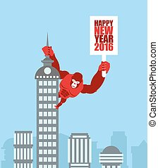 Monkey on skyscraper. King Kong holds a sign with new year....