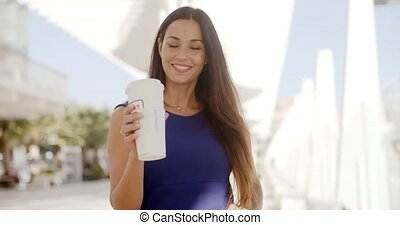 Attractive woman holding a large cup of coffee - Attractive...