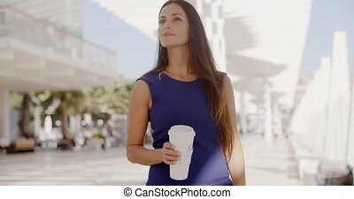 Attractive woman holding a large cup of coffee