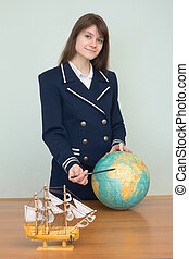 Woman in sea uniform with geographic globe