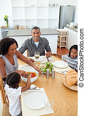 Ethnic family dining together