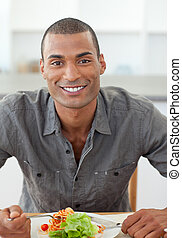 Portrait of ethnic man dinning in the kitchen
