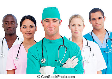Portrait of multi-ethnic medical team against a white...