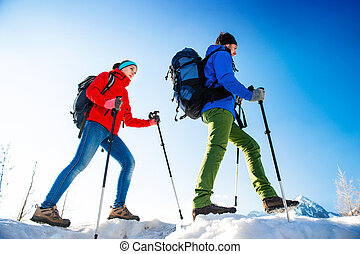 Young couple on a hike - Young couple hiking outside in...