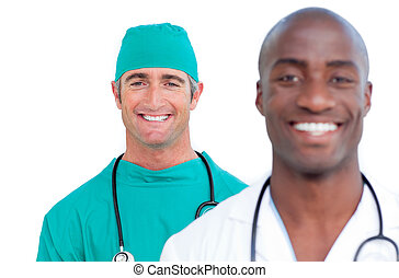 Two atractive male doctors against a white background