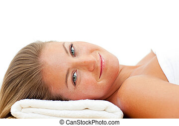 Portrait of charming woman relaxing after a spa treatment