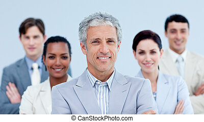 Smiling business team showing ethnic diversity against a...